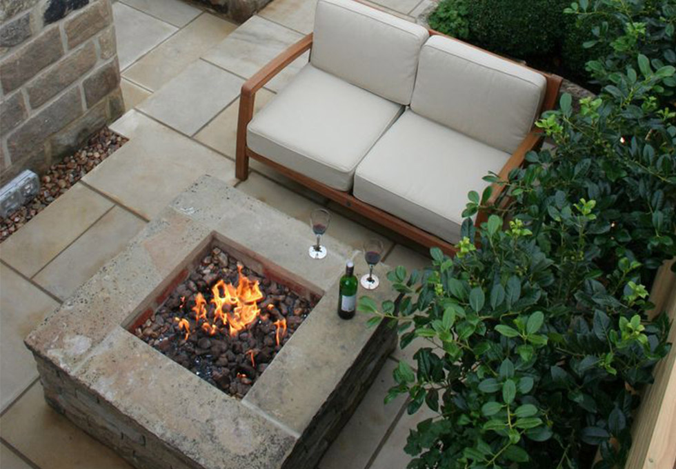 Enclosed garden seating area with fire pit