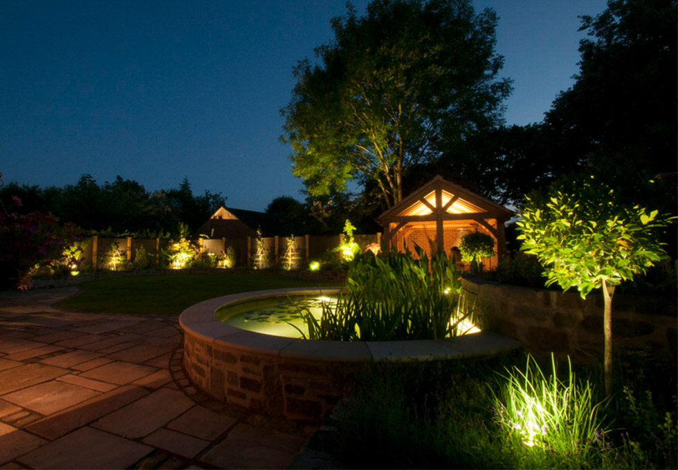 Garden with outdoor kitchen at night